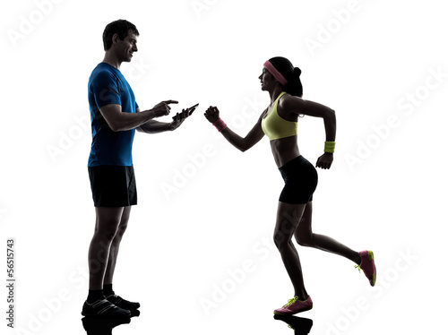 Wall mural woman exercising jogging man coach using digital tablet