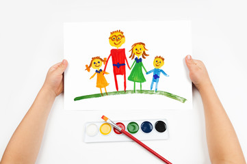 Child draws the family watercolors