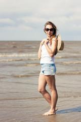 Sexy girl in sunglasses on beach.