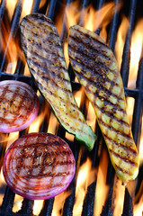Grilling vegetables over open flame