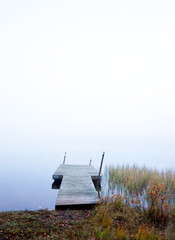 empty jetty in foggy river