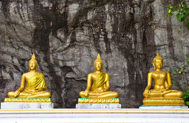 Three Lord Buddha statue in the cave Thailand