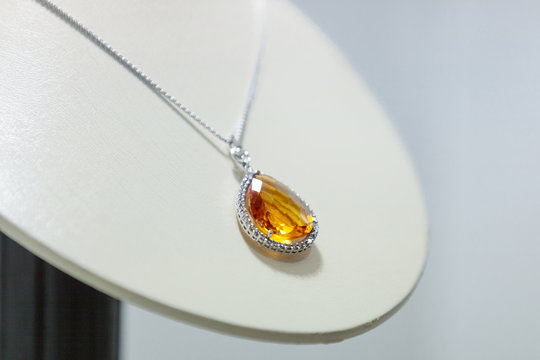 Close up of yellow sapphire necklace on the showcase