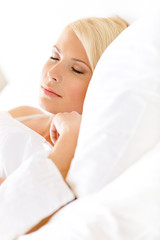 Close up view of sleepy woman in bed lying