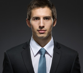Front view of self-confident business man in dark suit