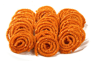 Traditional indian snack - chakali, isolated on white.