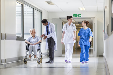 Doctors Nurse senior Female Patient in Hospital Corridor