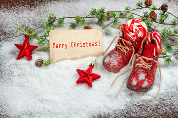 christmas decoration red balls, stars and antique baby shoes