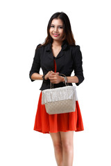 Young asian woman holding handbag