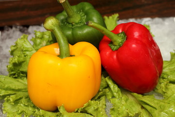 Wall Mural - Red yellow and green pepper on vegetables