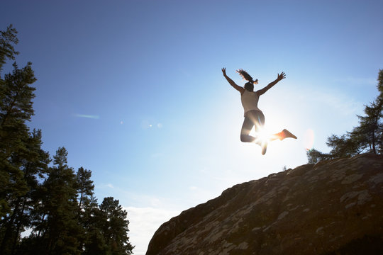 Silhouette Of Teenage Girl Leaping In Air