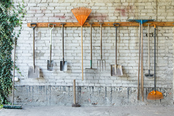 Group of garden tools on a wall