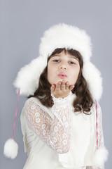cute girl white dressing blow snowflakes