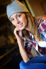 Young trendy girl with hat looking at camera