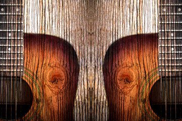 Acoustic guitar art on wooden background