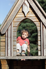 Child at wooden house