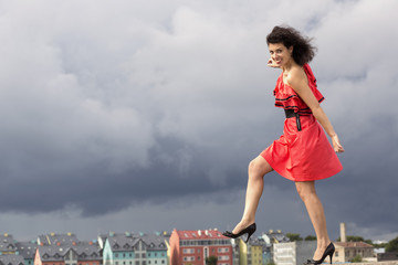 Woman in nice dress stepping on background