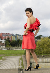 Woman in nice dress posing at stairs