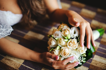caucasian bride holding wedding bouquet