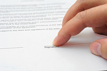 businessman showing to sign agreement