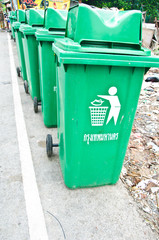 Green Plastic Waste Container In The Park