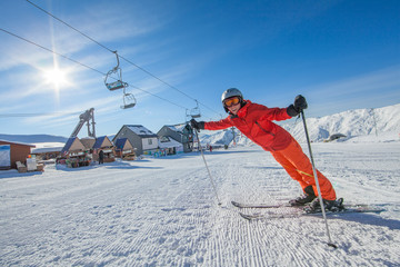 Foto op Aluminium Ontspanning Skier is posing at camera at Gudauri resort in high mountaing of