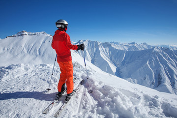 Skier is posing at camera at Gudauri resort in high mountaing of