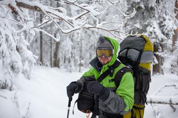 Hiker walking in winter Carpathian mountains