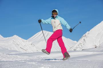 Skier is posing at camera at Gudauri resort in high mountaing of