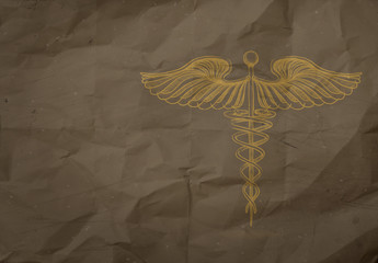 hand drawn Caduceus on wrapping recycle paper background