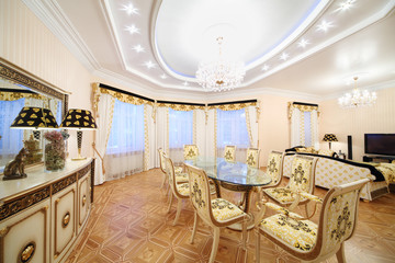 Living and dining room with luxury gilt furniture