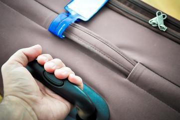 closing a luggage zipper