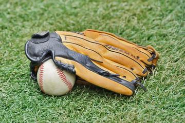 Baseball ball and Glove on grass