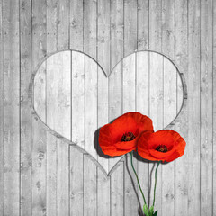 poppies,  the wooden background and white heart