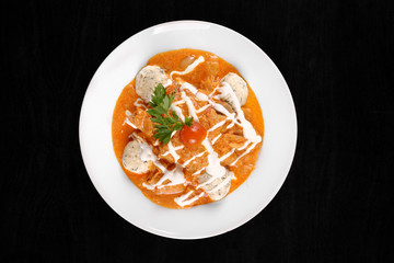 Delicious stew on isolated black background