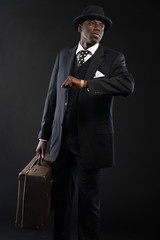 Retro african american traveller wearing striped suit and tie an