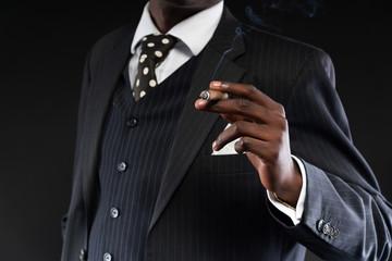 Close-up of hand of retro african american mafia man wearing str