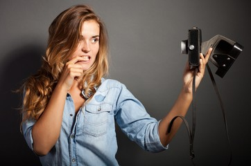 Silly photographer woman taking pictures herself old camera
