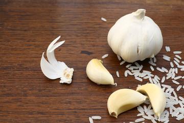 Garlic and rice on grunge chopping board