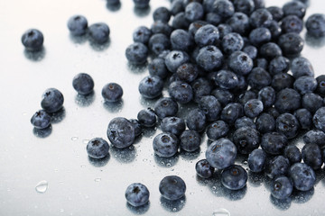 Blueberries on metal background