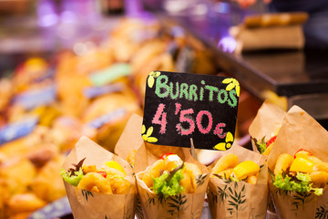 Burrito stall in a indoors market.