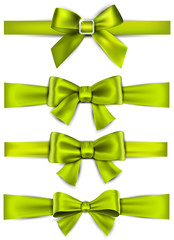 Satin green ribbons. Gift bows.