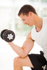 young athlete lifting weights
