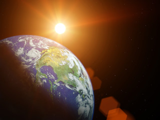 Planet earth in space with sun shining.