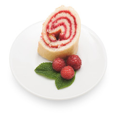 Sweet roll cake with raspberry jam and berries, isolated on a wh