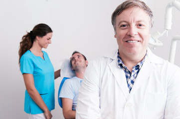 Portrait of a dentist, assistant, and their patient.