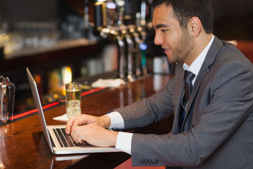 Focused businessman working on his laptop