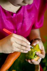 Woman hands carving papaya