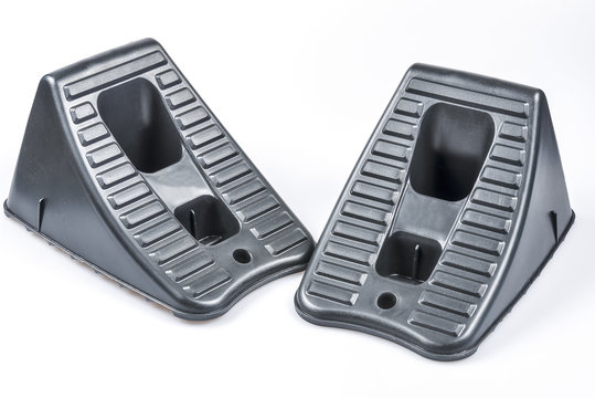 Pair of wheel chocks on a white background