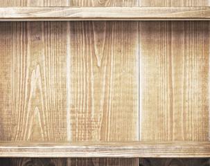 Empty shelfs on wooden wall